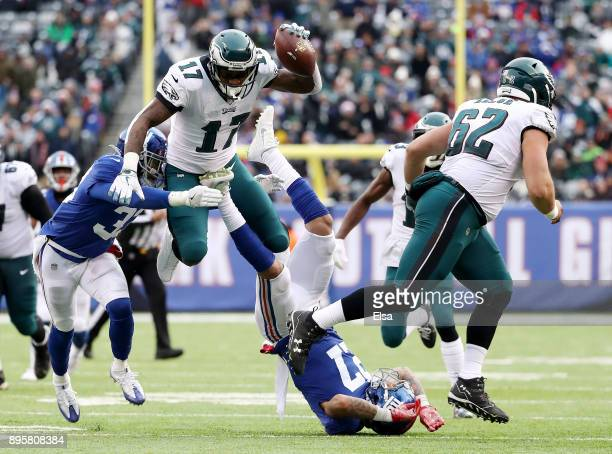 Alshon Jeffery of the Philadelphia Eagles is hit by Andrew Adams of the New York Giants as he leaps over Darian Thompson of the Giants as at MetLife...