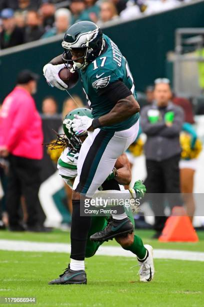 Alshon Jeffery of the Philadelphia Eagles is tackled by Darryl Roberts of the New York Jets during the third quarter at Lincoln Financial Field on...
