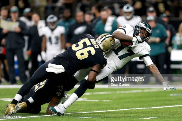 Alshon Jeffery of the Philadelphia Eagles is tackled by Demario Davis of the New Orleans Saints during the fourth quarter in the NFC Divisional...