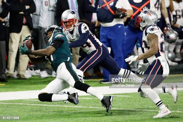 Alshon Jeffery of the Philadelphia Eagles makes a catch defended by Stephon Gilmore of the New England Patriots in the second quarter of the Super...