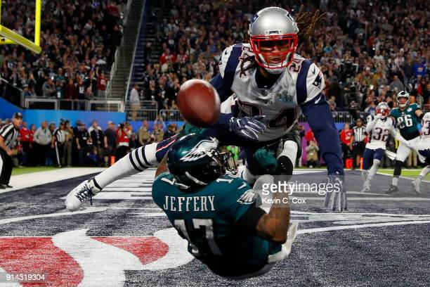 Alshon Jeffery of the Philadelphia Eagles misses the pass attempt under pressure from Stephon Gilmore of the New England Patriots during the second...