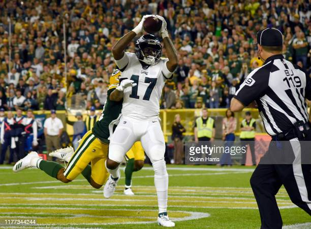 Alshon Jeffery of the Philadelphia Eagles scores a touchdown in the second quarter Jaire Alexander of the Green Bay Packers at Lambeau Field on...