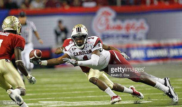 Alshon Jeffery of the South Carolina Gamecocks fails to pull in this reception against Mike Harris and Greg Reid of the Florida State Seminoles...