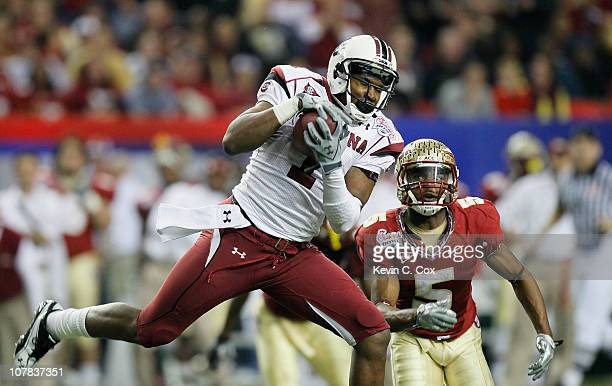 Alshon Jeffery of the South Carolina Gamecocks pulls in this reception against Greg Reid of the Florida State Seminoles during the 2010 ChickfilA...