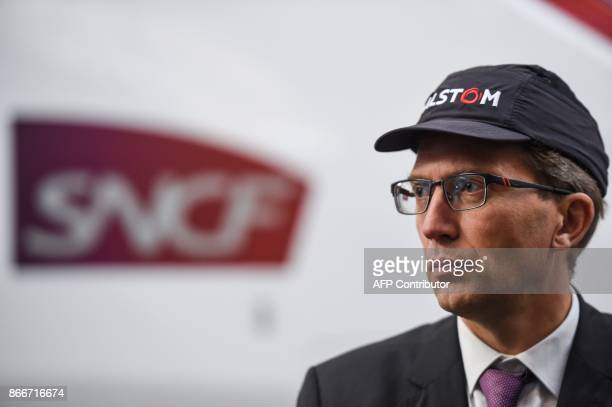 Alstom CIO Henri PoupartLafarge looks on as he visits the site of French train maker Alstom in Belfort on October 26 2017 / AFP PHOTO / SEBASTIEN...