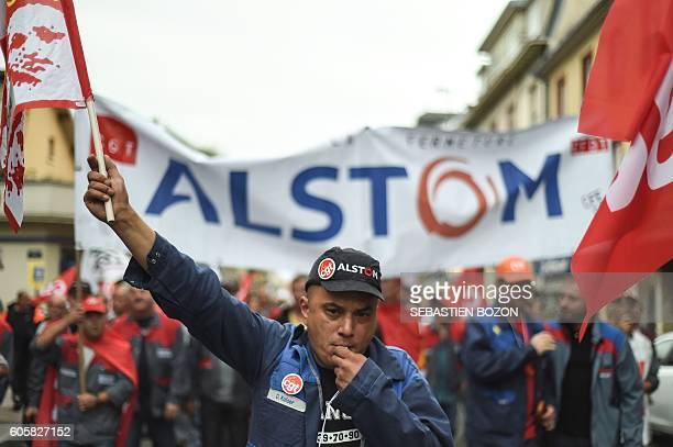 Alstom employees demonstrate to protest against the closure of the French power and transport engineering company Alstom factory in Belfort also...