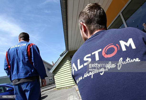 Alstom SA employees stand in front of the main Factory Building on May 5 2014 in Belfort France General Electric is seeking to take over Alstom one...