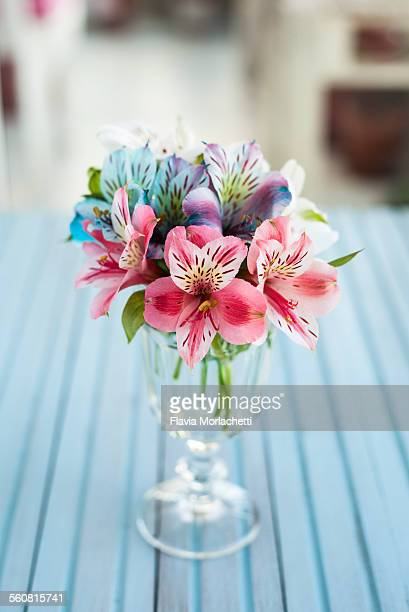 alstroemeria bouquet in a glass vase - alstroemeria stock pictures, royalty-free photos & images