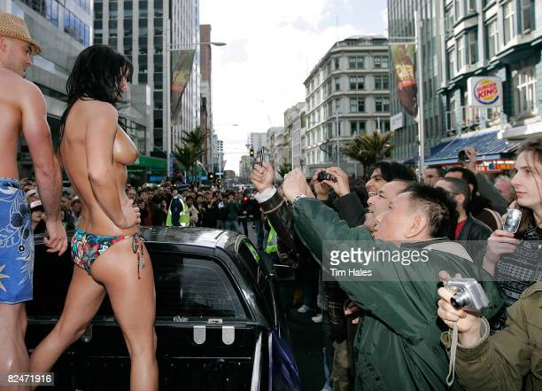 Alt TV Naked Newsreader Lisa Lewis rides down Queens Street during the annual `Boobs on Bikes' parade on Queens Street August 20, 2008 in Auckland,...