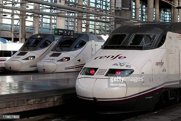 Alta Velocidad Espanola highspeed trains operated by Renfe Operadora SC sit beside platforms at Atocha train station in Madrid Spain on Saturday Aug...