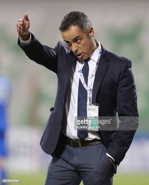 CORRECTION AlTaawoun's Portuguese head coach Jose Manuel reacts on the sidelines during their Asian Champions League football match between Iran's...