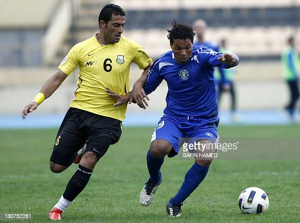 AlTalaba Club's player Karim Walim vies for the ball against Arbil's Club's Mahdi Karim during the opening match of the Iraqi League football at the...
