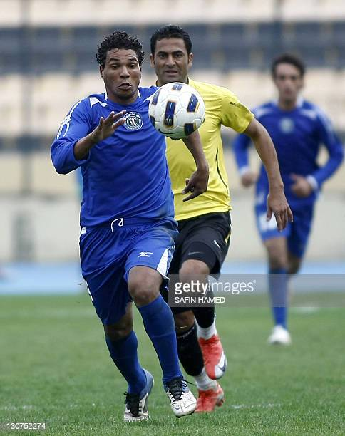 AlTalaba Club's player Karim Walim vies for the ball chased by Arbil's Club's Mahdi Karim during the opening match of the Iraqi League football at...
