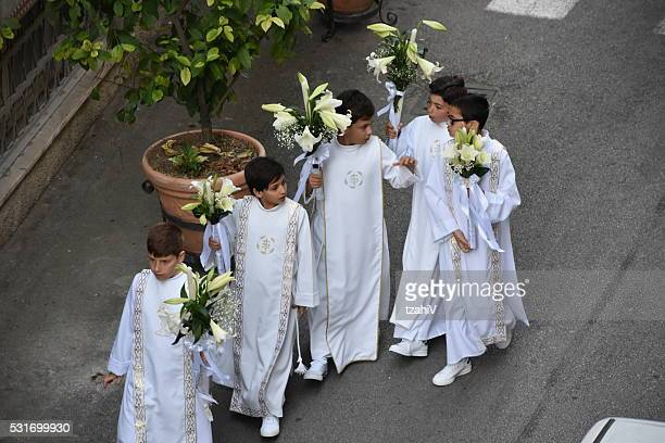 Altar boy walking the streets of Italy
