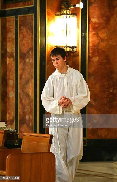 Altar boy wearing religious robes