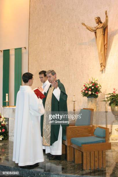 Altar boys and a priest in the Immaculate Conception Catholic Church