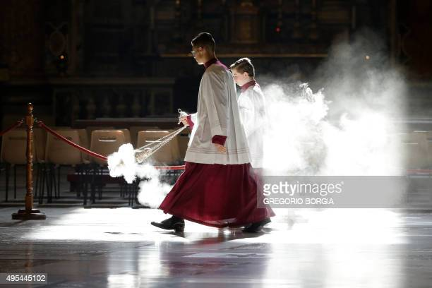 Altar boys asperse incense as they wait for the arrival of Pope Francis on the occasion of a Mass for cardinals and bishops who died in the past year...