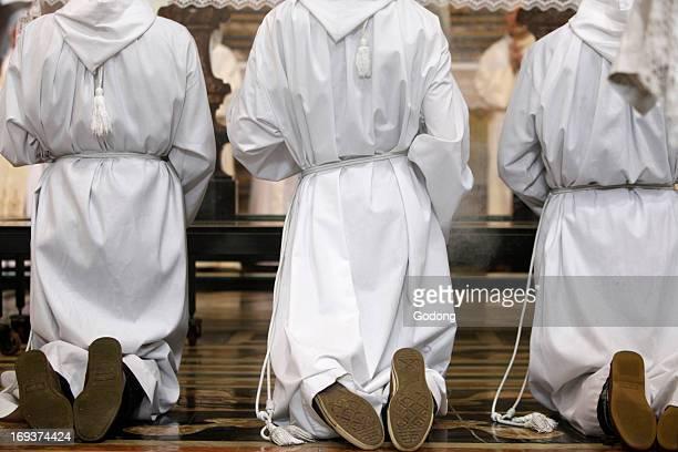 Altar boys kneeling at mass in San Filippo Neri church