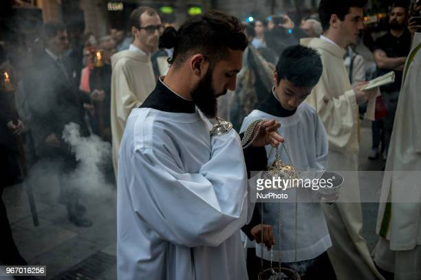 Altar boys prepare incense during the Corpus Christi procession in Barcelona Spain on 3rd June 2018 The solemnity of Corpus Christi in Barcelona has...