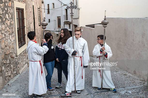 Altar boys wait to walk the way of the cross or 'Via Crucis' during the procession of 'La Subida al Monte Calvario' in Pastrana on April 3 2015 near...