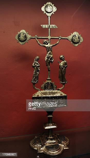 Altar crucifix with reliquary depicting the four evangelists on a blue enamel ground Contains a relic of a Holy Cross and other 14th century From...