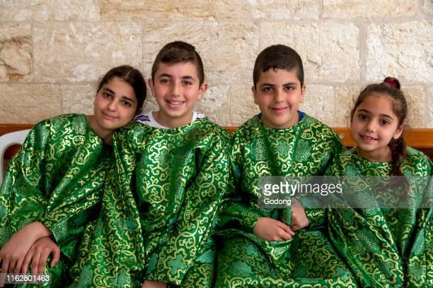 Altar girls and boys in the melkite church of Nazareth Galilee israel