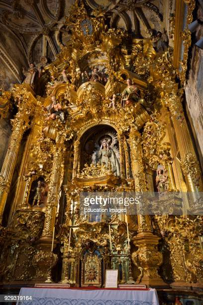 Altar of the Rosary with Madonna and child in Saint Mary of the Assumption basilica in Arcos de la Frontera Spain.