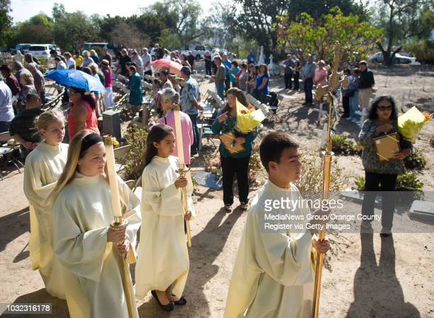 Altar servers exit San Juan Capistrano's annual Mass of Remembrance at the Old Mission Cemetery Saturday morning ///ADDITIONAL INFO...