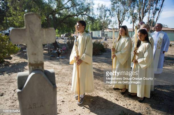 Altar servers led by Kevin Hirose of San Clemente wait for the start of San Juan Capistrano's annual Mass of Remembrance at the Old Mission Cemetery...