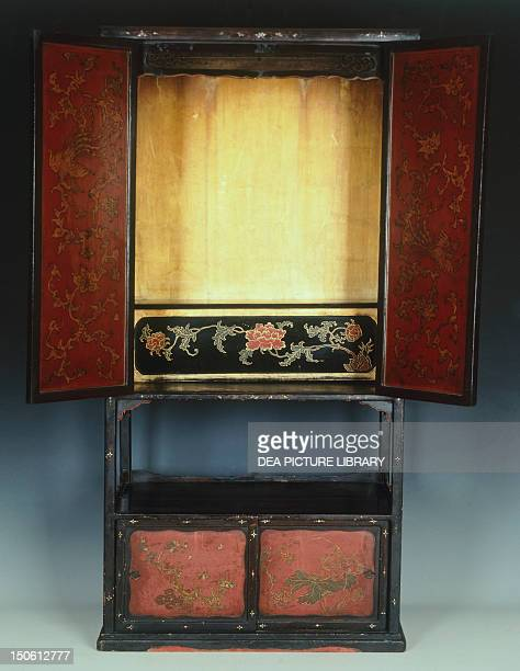 Altar with two doors decorated with figures of monks and floral motifs produced in Ryukyu 18th century wood lacquer gold pearl and metal 163x813x49...