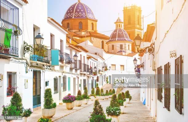 altea street and church of the virgin de consuelo. spain - alicante stock pictures, royalty-free photos & images