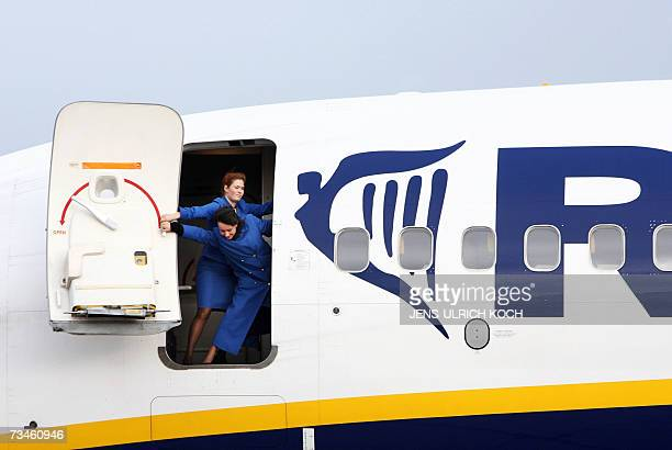 Ryanair Flight attendants close the airplane door of a Boeing 737800 at the AltenburgNobitz airport eastern Germany 01 March 2007 Ryanair added...