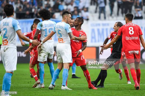 Altercation between Lucas Ocampos of Marseille and Claudio Beauvue of Caen during the Ligue 1 match between Marseille and Caen at Stade Velodrome on...