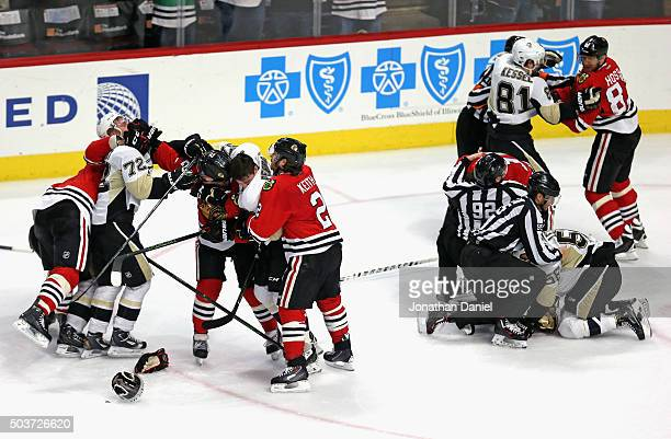 Altercations break out in the third period between the Chicago Blackhawks and the Pittsburgh Penguins at the United Center on January 6 2016 in...