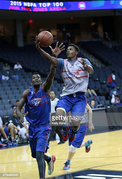 Alterique Gilbert in white with the finger roll during the NBPA Top 100 Camp on June 18 2015 at John Paul Jones Arena in Charlottesville Virginia