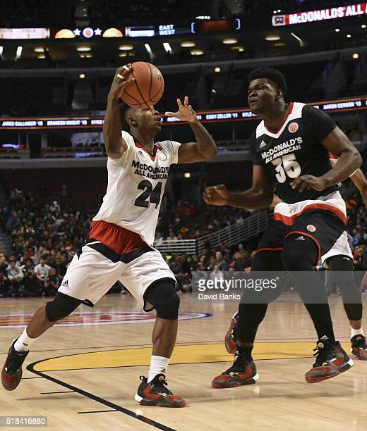 Alterique Gilbert of the West team drives around Udoka Azubuike of the East team during the 2016 McDonalds's All American Game on March 30 2016 at...