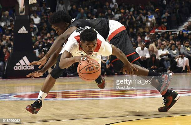 Alterique Gilbert of the West team drives past Andrew Jones of the East team during the 2016 McDonalds's All American Game on March 30 2016 at the...
