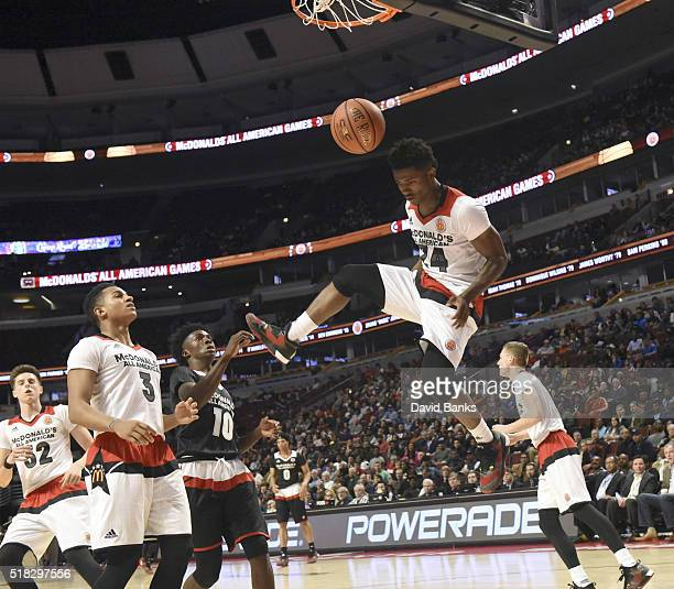 Alterique Gilbert of the West team finishes a dunk against the East team during the 2016 McDonalds's All American Game on March 30 2016 at the United...