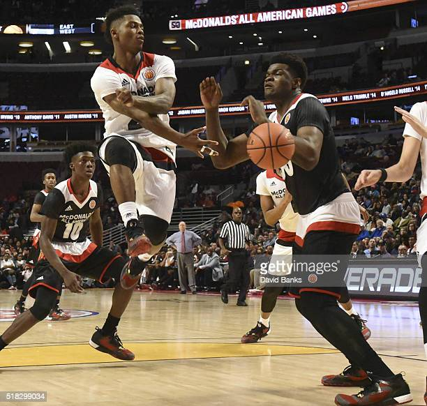 Alterique Gilbert of the West team passes around Udoka Azubuike of the East team during the 2016 McDonalds's All American Game on March 30 2016 at...