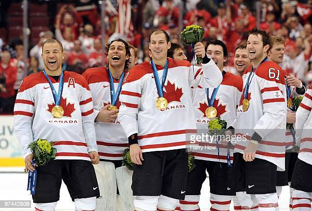 Alternate Captain Jarome Iginla, goaltender Roberto Luongo, Ryan Getzlaf, Drew Doughty, Brenden Morrow and Rick Nash of Canada laugh in celebration...
