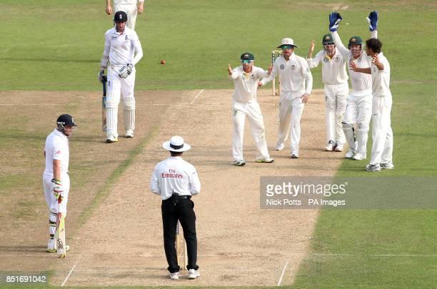 *Alternate Crop* Australia captain Michael Clarke reacts to umpire Aleem Dar with teammates Ed Cowan, Brad Haddin and bowler Ashton Agar after...
