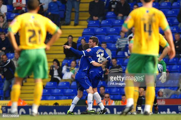 **Alternate crop** Birmingham City's Franck Queudrue's is restrained by team mate Sebastian Larsson during an altercation with Norwich City's Alan Lee