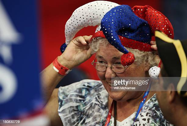 Alternate delegate Karen Skrill of Randolph VT wears a jester hat on the arena floor before the start of the abbreviated first day of the Republican...