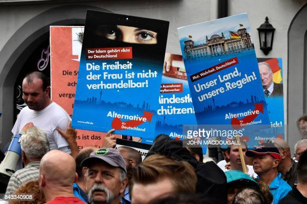 Alternative for Germany 's demonstrators demonstrate prior a CDU electoral meeting in Torgau eastern Germany on September 6 2017 / AFP PHOTO / John...