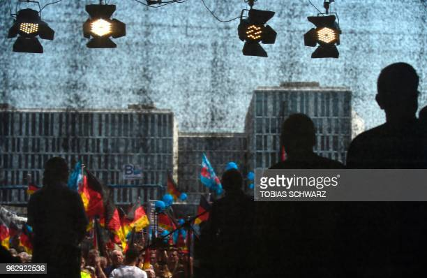 Alternative for Germany 's demonstrators gather at the main station in Berlin to attend the demonstration for the future of Germany called by the...