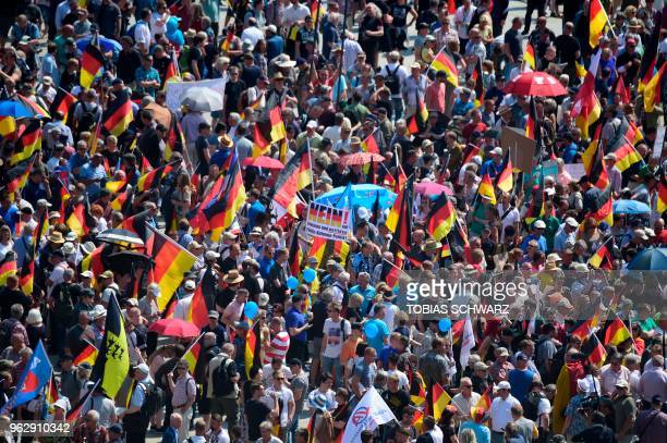 Alternative for Germany 's demonstrators holding placards and German flags gather at the main station in Berlin to attend the 'demonstration for the...