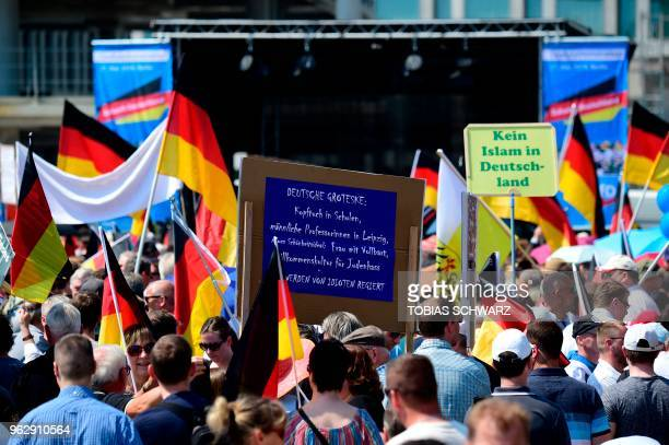 Alternative for Germany 's demonstrators holding placards reading German grotesque headscarf in schools male professors in Leipzig new beauty ideal...