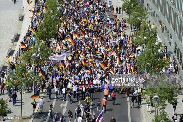 Alternative for Germany 's demonstrators leaded by Coleader of the parliamentary group of the AfD Alexander Gauland leadership member of the AfD...