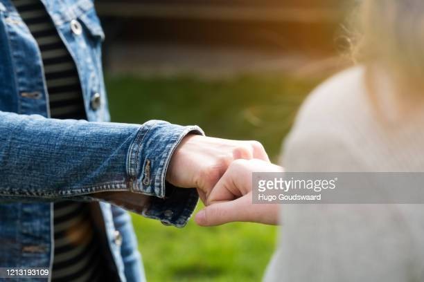 alternative handshake. bumping fist to say hello. corona covid-19 meeting. - elbow bump stock pictures, royalty-free photos & images
