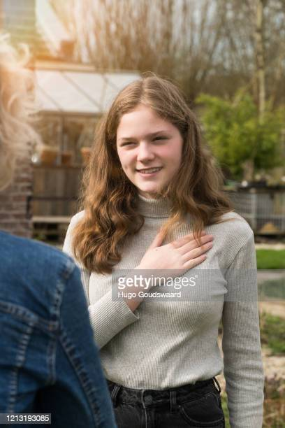 alternative handshake. teenager placing hand on heart. corona covid-19 meeting. - elbow bump stock pictures, royalty-free photos & images